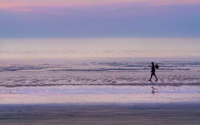 A local taking a stroll on Bordi Beach