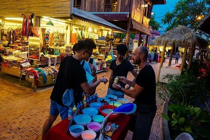 Tourists bargaining at a shop of the famous Cambodian Angkor night market