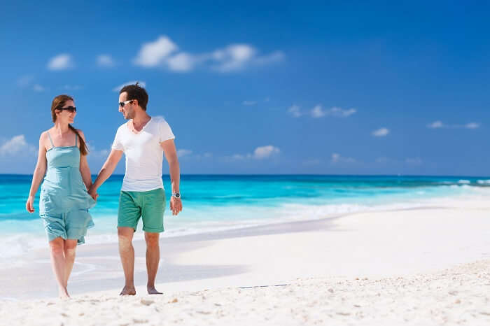 Panorama of a couple on a tropical beach at Anguilla in Caribbean