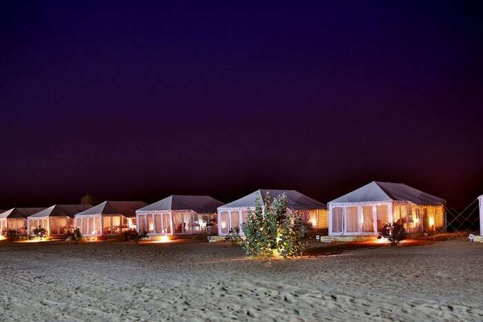 Well-lit tents of Winds Desert Camps