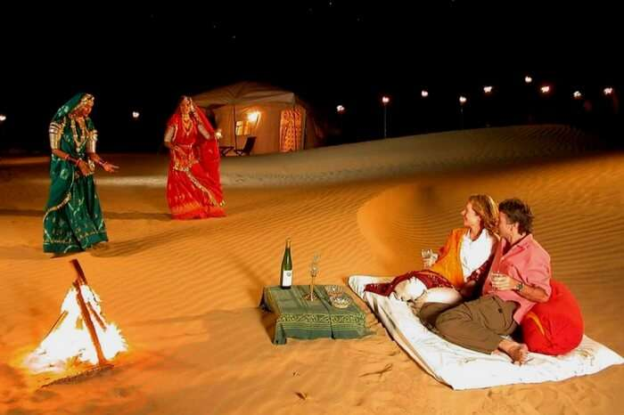 Tourists watching the Rajasthani folk dance in a camp at night