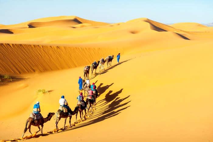 A caravan moving across the desert
