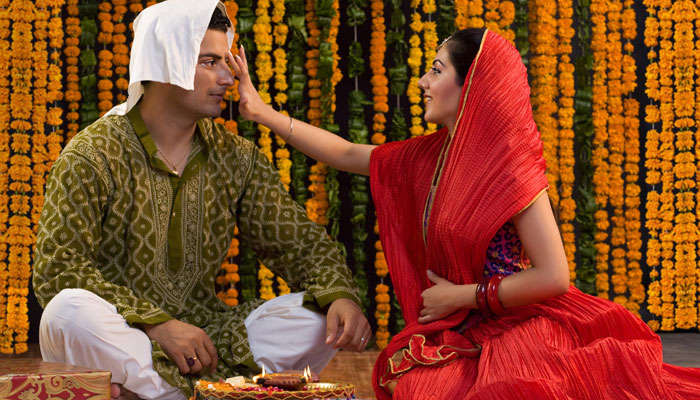 A sister puts tilak on the forehead of her brother during the Bhai Dooj celebrations in India