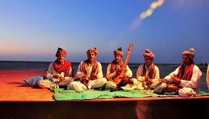 Performers performing a folk song during the Rann Utsav