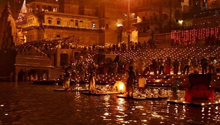 Worshippers gather on the ghats of river Ganga in Varanasi to celebrate the Ganga Mahotsav