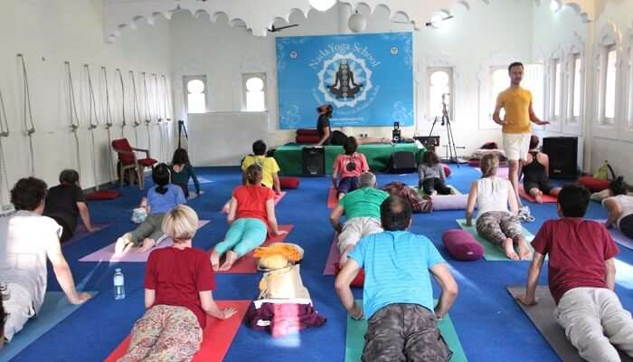 Participants practice yoga during the International Yoga and Music Festival in Rishikesh