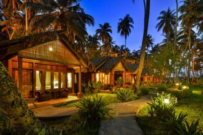 An evening shot of the well-lit cottages at the Sea Shell Resort in Havelock