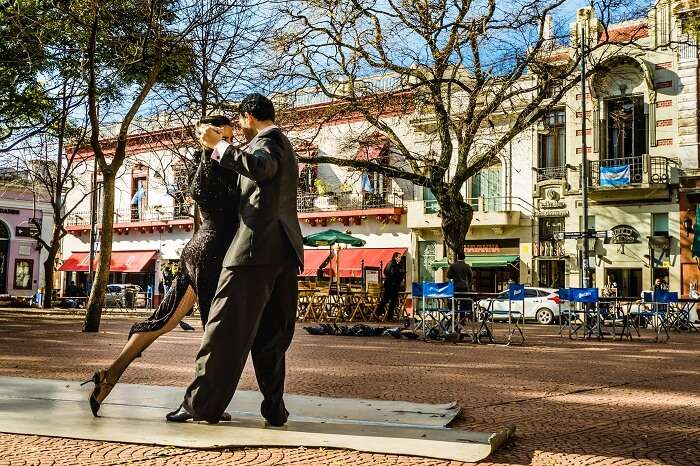 Two unidentified tango dancers performing at Plaza Serrano in San Telmo neighborhood in Buenos Aires