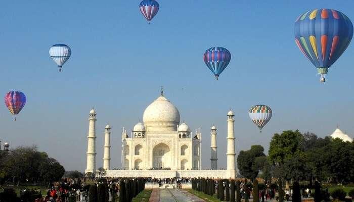 Hot air balloons flying over Taj Mahal during the Taj Balloon Festival