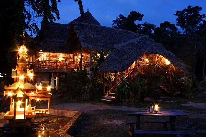 The well-lit cottages in the Wild Orchid Resort in Andaman on an evening