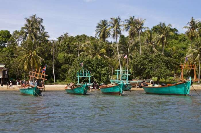 Tourists on a boat at Koh Tonsay island in Cambodia