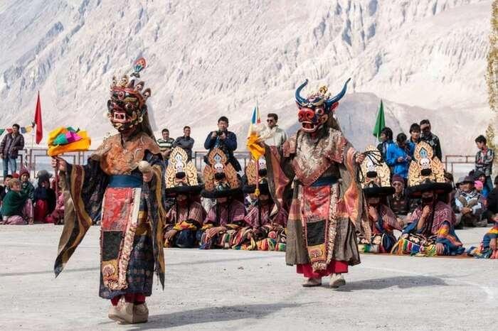 Masked dancers perform at Matho monastery in Leh