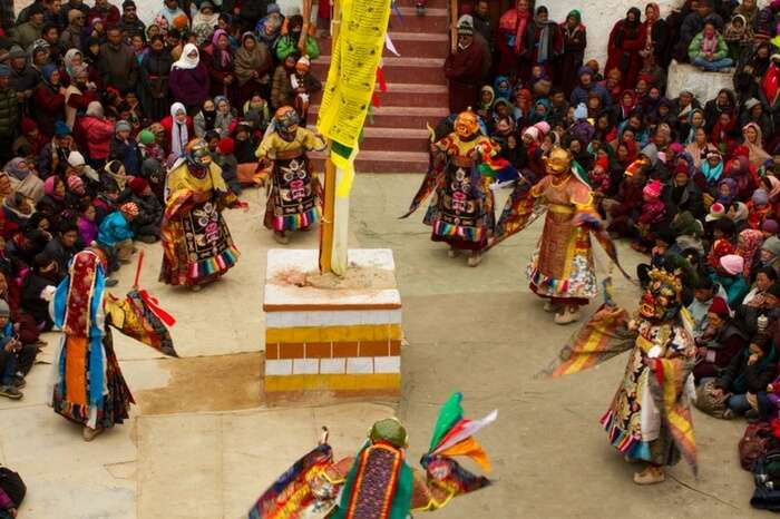 Masked dancers performing a sacred ritual during the festival