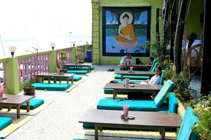 Visitors enjoying food and view in Lotus Lounge