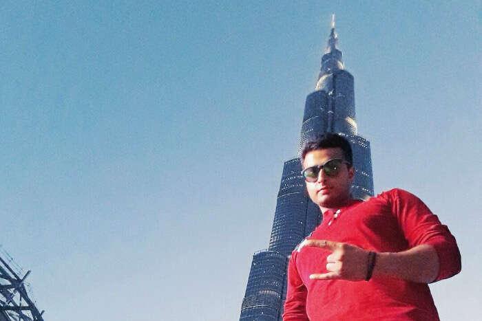 abhinav standing below the Burj Khalifa