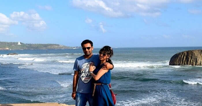 Priyanshu with his wife on a sea beach in Sri Lanka