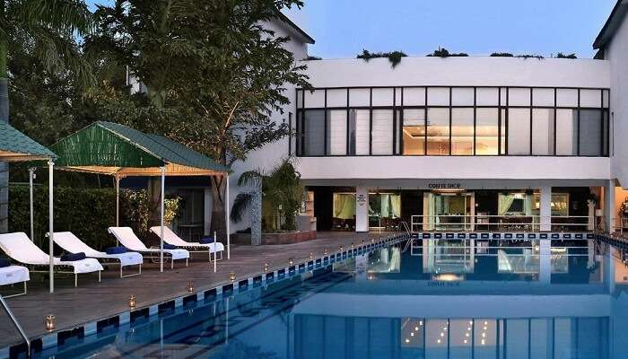 The swimming pool and main building at the Best Western Country Club in Manesar