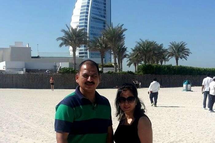 A couple standing in front of Burj Al Arab Dubai