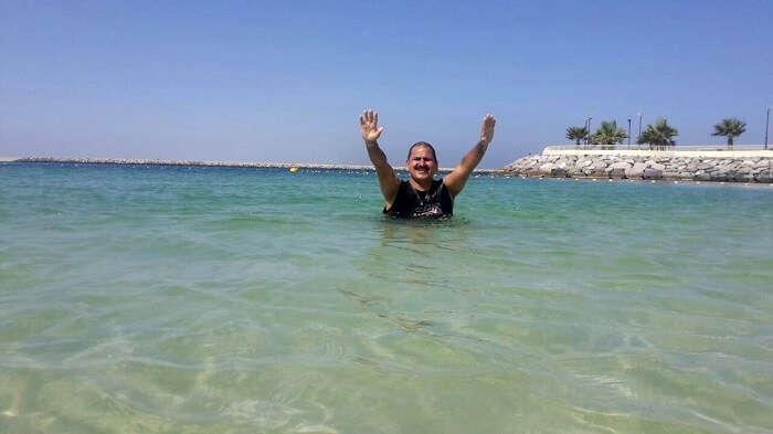 A man enjoying swimming in the beach