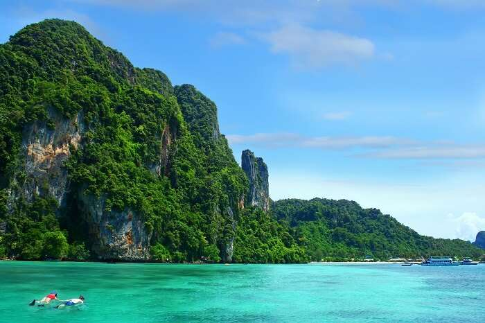 A couple takes a snorkeling tour at the Phi Phi island