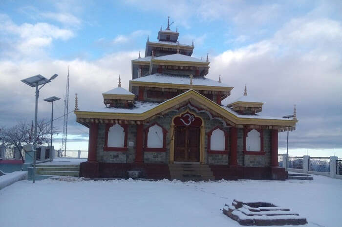 A snap of the snow-covered Surkanda Devi Temple in Kanatal during winters