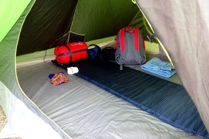 A well laid out tent during snow camping at Prashar Lake