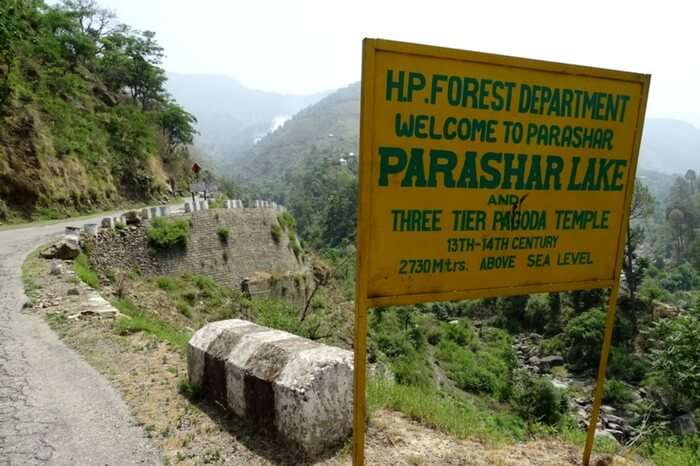 A signboard indicating your arrival at Prashar Lake