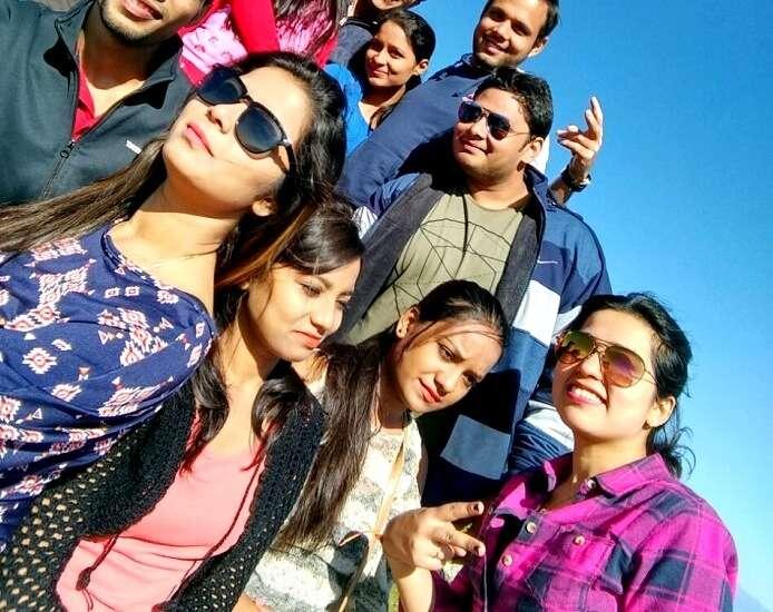 Group of travelers click a selfie in Khajjiar