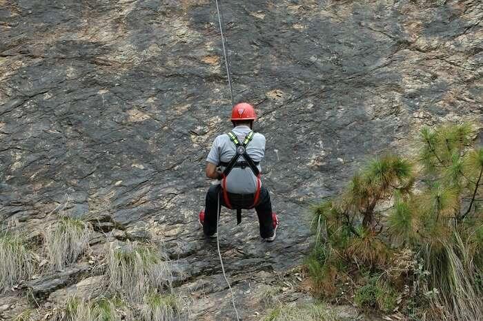 One of the adventurous travelers tries rappelling in Kanatal
