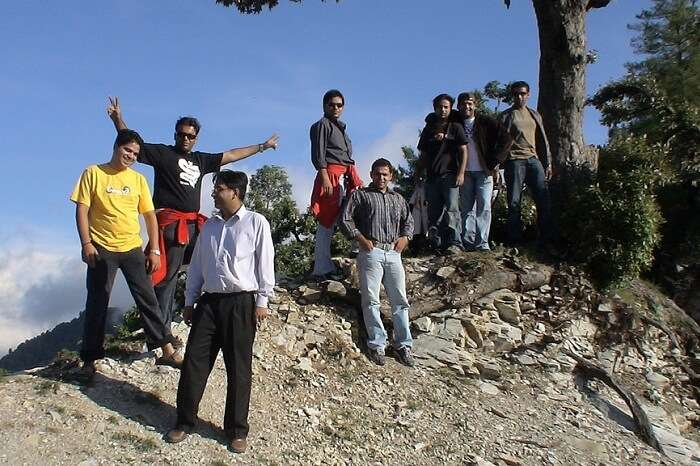 A group of trekkers taking a break while trekking in Kanatal