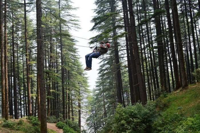 A person tries Valley Crossing in Kanatal