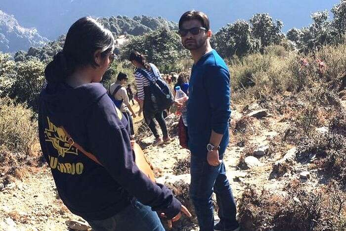 A man gets his picture clicked during downhill trek