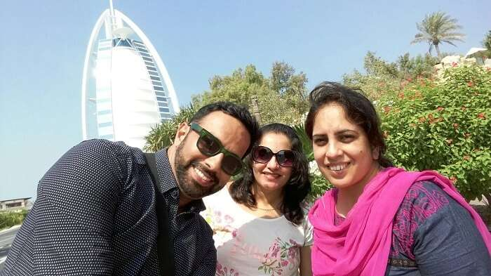 Family clicking selfie in front of Burj-al-Arab