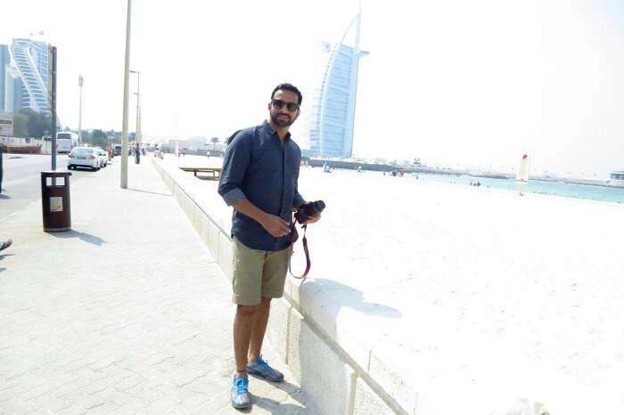 Man posing near burj-al-arab in Dubai