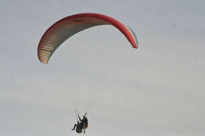 Man enjoying paragliding with wingman