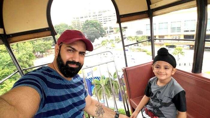 Riding the cable car with his son