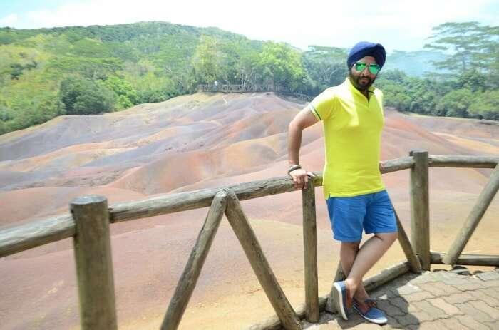 man posing near seven coloured earth