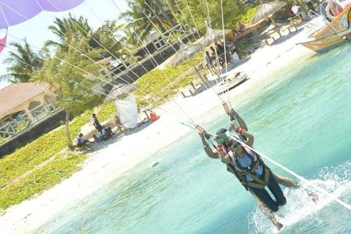 Couple engaged in the parasailing adventure