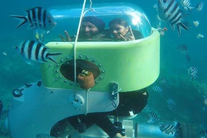 Couple enjoying an underwater scooter adventure