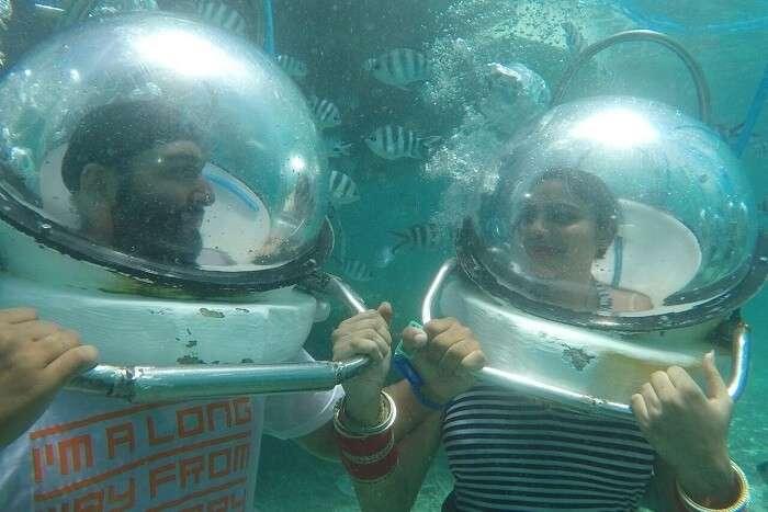couple enjoying underwater seawalking
