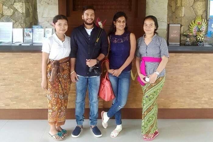 Couple taking picture with locals of Bali