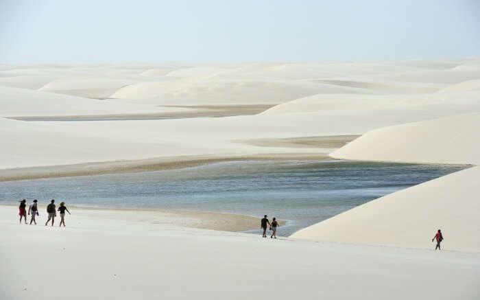People walking around Lencois Maranhenses National Park