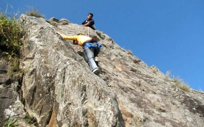 A person trying rock climbing in Mukteshwar