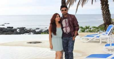 Amit standing on a sea beach with his wife during a honeymoon trip to Mauritius