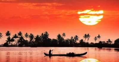 A boat sailing in Kerala at the time of sunset