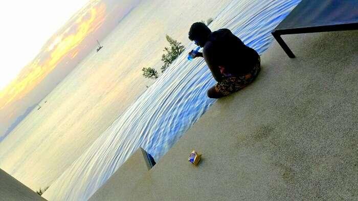 Jegen enjoying the sunrise at Conrad Hotel in Koh Samui