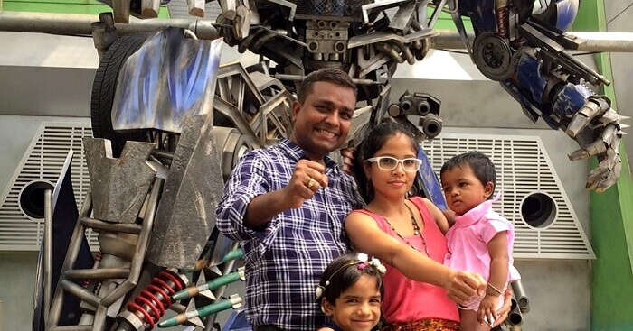 Govind with his family on a trip to Singapore