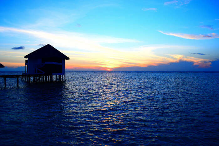 kishor & wife enjoying sunset from their water villa in maldives