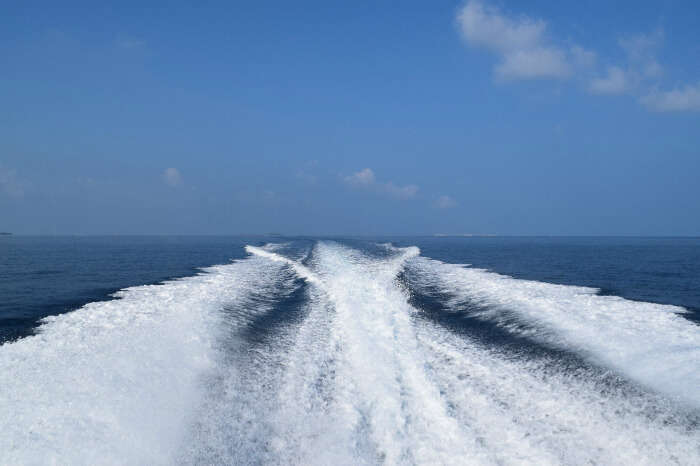 kishor & wife sailing away in a speed boat