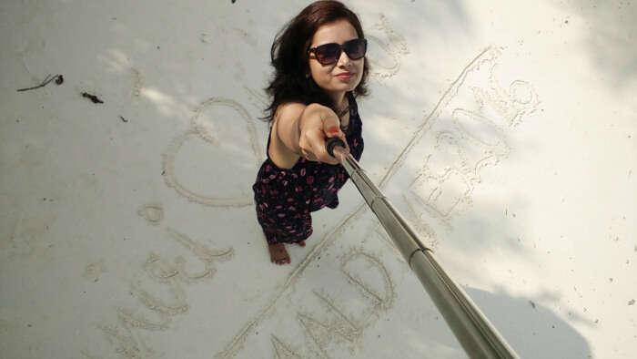 kishor's wife taking a selfie on the beach